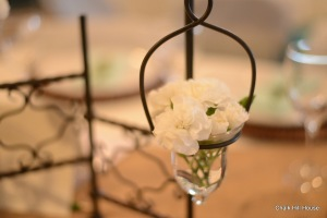 Miniature white carnations in glass votive jars for a rustic burlap picnic wedding