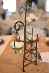 Miniature White Carnations in a Wrought Iron wedding centerpiece on burlap
