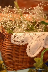 Baby's Breath and Antique Lace in a Picnic Basket at a Rustic Burlap Wedding