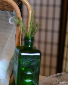 Green Glass bottles with rosemary at a rustic picnic burlap wedding