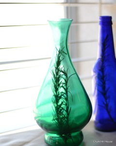 teal and cobalt glass with rosemary at a rustic picnic wedding