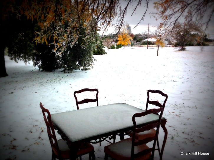 chalk hill house winter ice storm patio table covered with snow
